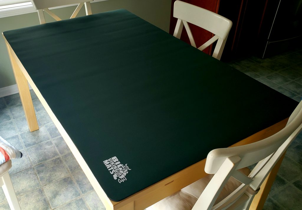 green dining table gaming mat