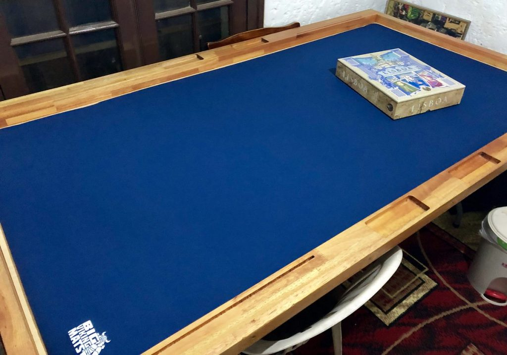 custom cut blue omat on gaming table
