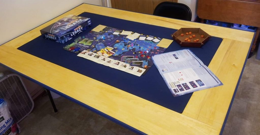 Board game on blue neoprene gaming mat