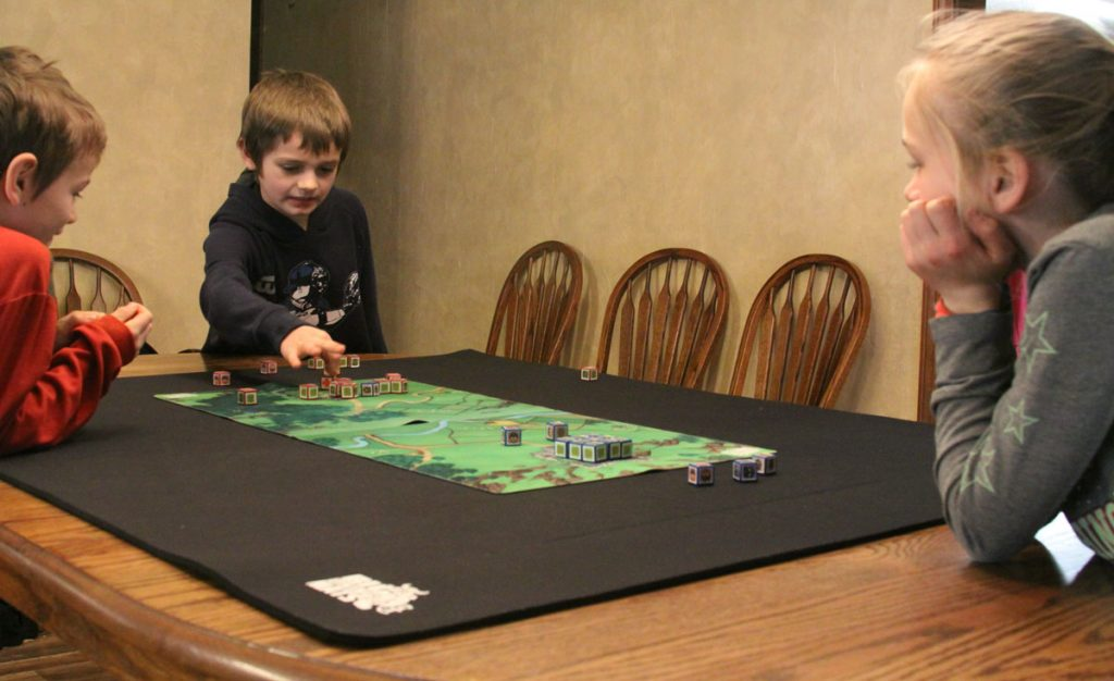cube quest on neoprene gaming mat