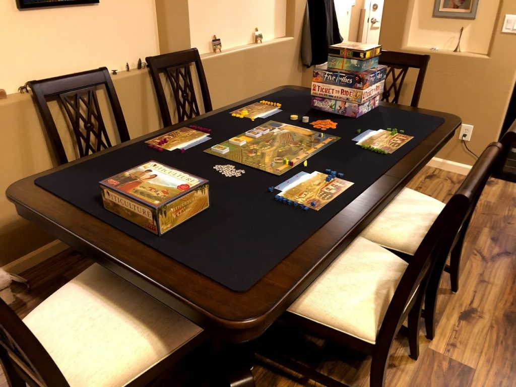 Board game on custom gaming table mat black