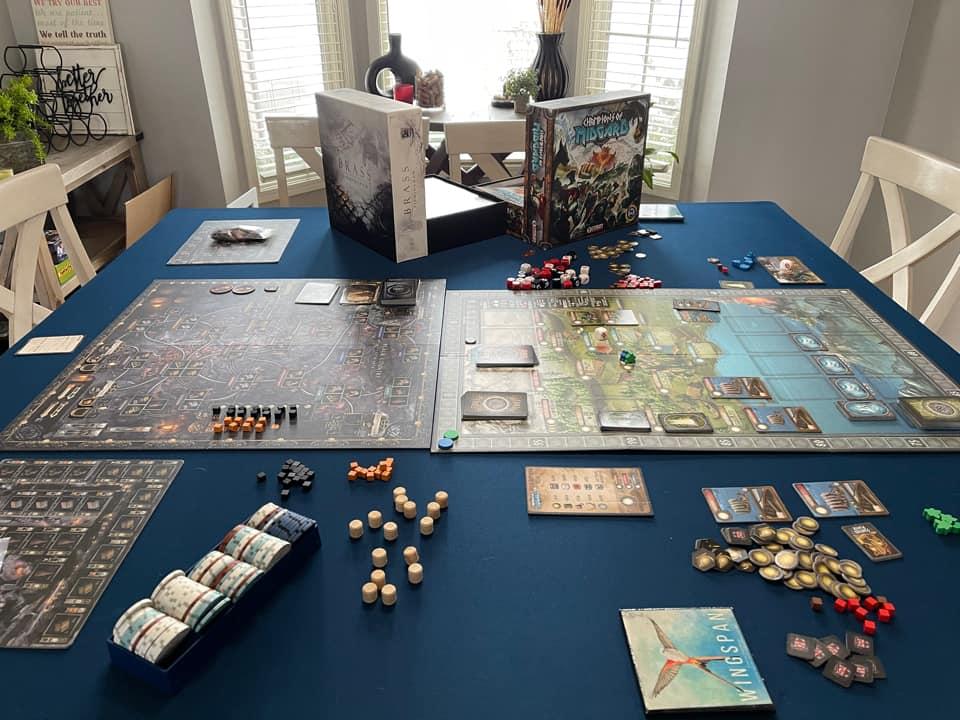 big board game setup on custom cut gaming mat