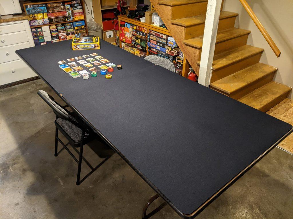 large custom black moat on folding table